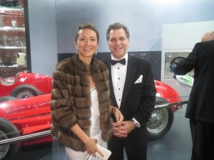 Vanessa Moriel and John Bukowicz pose in front of an Alfa Romeo on the evening of the Black Tie Gala.