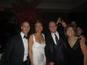 LEAR CTO Agis Liberakis, Vanessa Moriel, Lear CFO Jeffrey H. Vanneste, and his wife pose for a picture at the Lear After-Party.