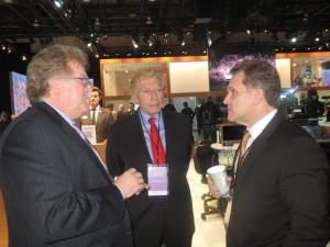 LIASE's John Bukowicz (right), Vic Doolan (middle), and AUDI Director Strategy, Mr. Reinhard Fischer, together at the Detroit Auto Show.