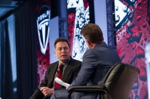 Elon Musk speaking at the Automotive News World Congress. Musk urged industry leaders to do more to advance the development of the electric car.