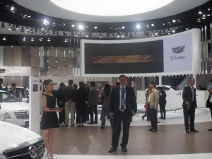 LIASE Group President and Managing Director Europe Wolfgang Doell standing in front of the Cadillac booth at the Shanghai Auto Show 2015. Cadillac unveiled a new Escalade as well as a hybrid version of its CT6 model.