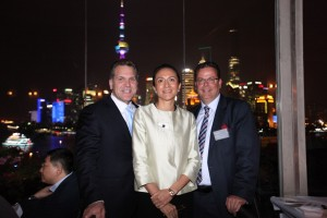 LIASE founders John Bucowicz, Vanessa Moriel, and Wolgang Doell pose for a photo in front of Shanghai's iconic Oriental Pearl Tower.