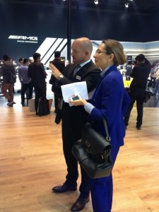 Daimler Greater China Vice President Procurement, Supplier Quality Joerg Burzer in discussion at the Benz booth with LIASE Group Board Member and Asia MD Vanessa Moriel.