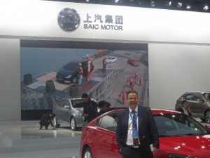 LIASE Group President and Managing Director Europe Wolfgang Doell, standing in front of the SAIC booth at the 2015 Shanghai Auto Show. SAIC unveiled a hybrid vehicle at the show.