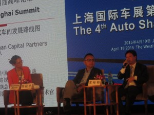 Dongfeng Motor Corporation Deputy Manager of the Strategy and Planning Departmen Wang Binbin speaking at the 4th Auto Shanghai Summit 2015. Dongfeng Motor unveiled a concept four-door coupe concept, the Venucia, at the Shanghai Auto Show. Venucia is a branch of the Dongfeng-Nissan joint-venture selling cars based on the Nissan Platform. Dongfeng also unveiled the Fengxing S500, a compact MPV; the Dongfeng Number 1, Dongfeng's largest sedan ever; and the Fenshen AX3, a new compact crossover SUV.