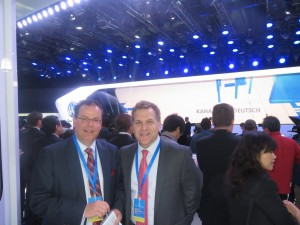 LIASE Group President and Managing Director Europe Wolfgang Doell (left) standing with LIASE Group Managing Director for the Americas John Bukowicz (right) in front of the Volkswagen stage at the 2015 Shanghai Auto Show.