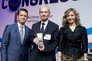 Christophe Aufrère, Vice President of Technology Strategy, Faurecia, accepts a 2015 L.E.A.D.E.R. award on behalf of his company. Faurecia was recognized in the supplier category for its innovations in weight reduction and energy efficiency. In 2014, the group registered 505 patents for new products, materials and manufacturing techniques.