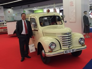 LIASE Group President and Managing Director Europe Wolfgang Doell stands next to an antique ambulance at the 2015 IAA.