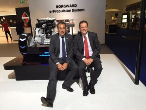 Automobilwoche Managing Director Helmut Kluger (left) posing next to LIASE Group President and Managing Director Europe Wolgang Doell in front of a Borgward engine.