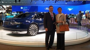 The LIASE Group's John Bukowicz, Managing Director for the Americas, and Vanessa Moriel, Managing Director Asia, pose at the Ford Booth of the LA Auto Show.