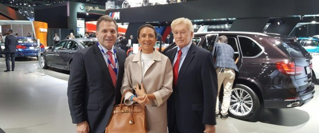 The LIASE Group's John Bukowicz, Managing Director for the Americas (left), Vanessa Moriel, Managing Director Asia (right) and Vic H. Doolan, Non-Executive Member of the Board, take a picture at the LA Auto Show.