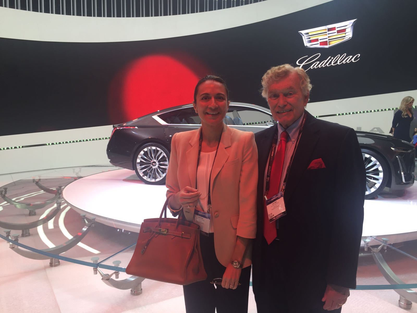 LIASE Group Managing Partner Asia, Vanessa Moriel, and Non-Executive Board Member, Vic H. Doolan, pose for a picture in front of the Escala Concept at the LA Auto Show.