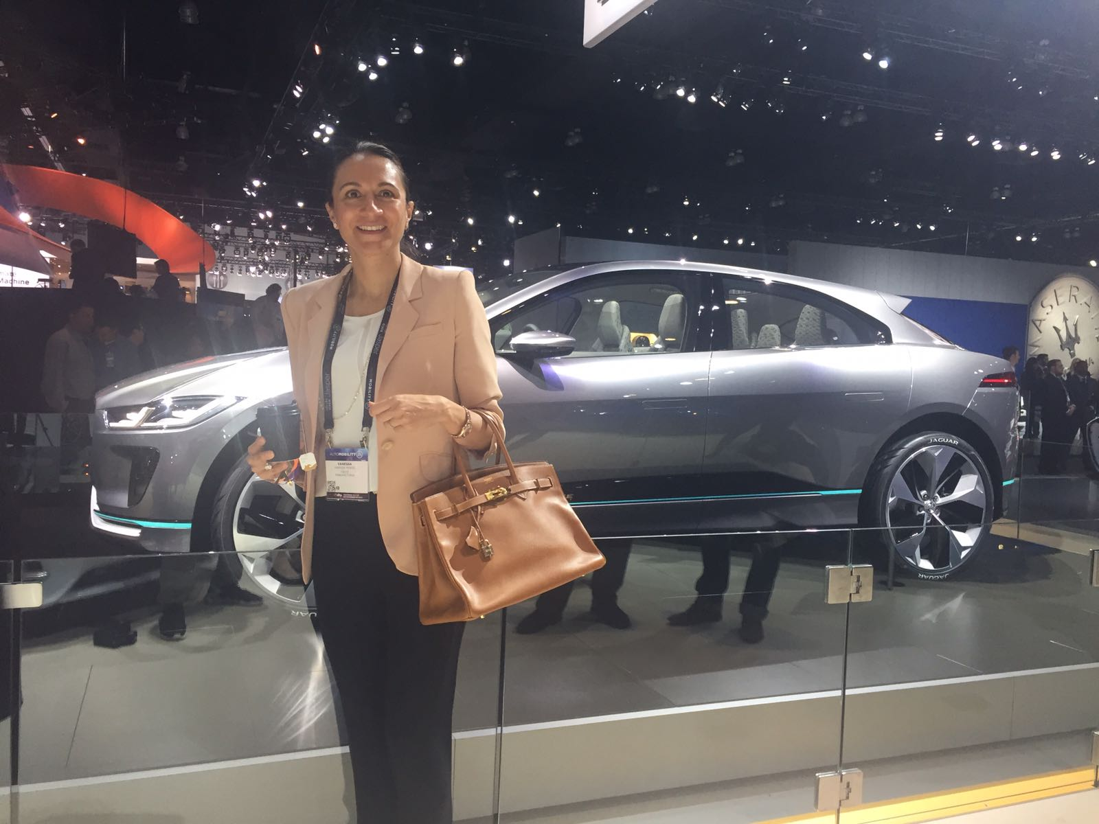 LIASE Group Managing Director Asia Vanessa Moriel stands in front of the Jaguar I-PACE Concept which made its North American debut at the LA Auto Show in 2016. The I-PACE is Jaguar's first fully electric car.