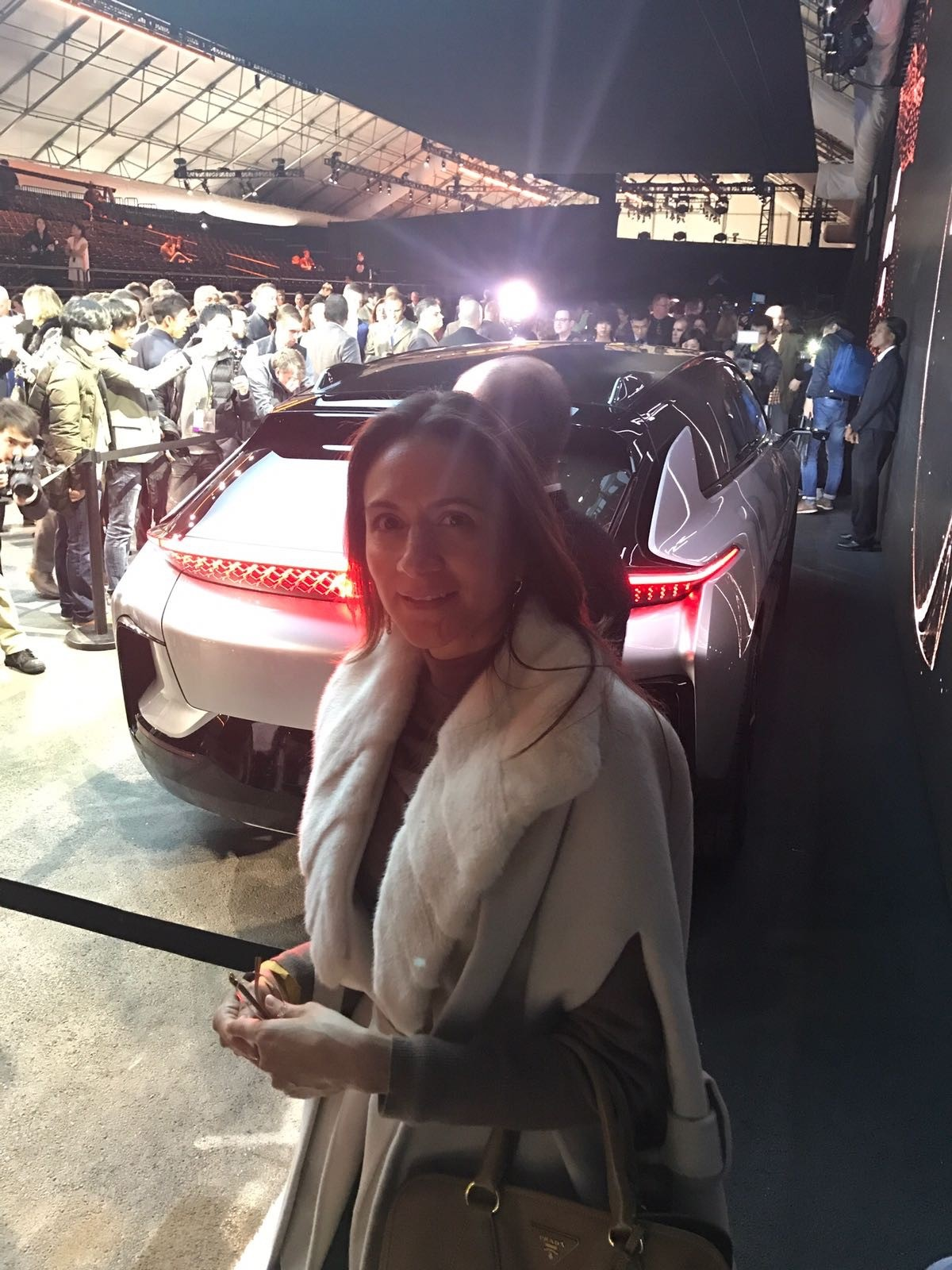 Vanessa Moriel, LIASE Group Managing Director Asia stands in front of the newly revealed FF 91 SUV at CES 2017 in Las Vegas. With the FF91, Faraday Future hopes to rival Tesla in the high-end all-electric car market.