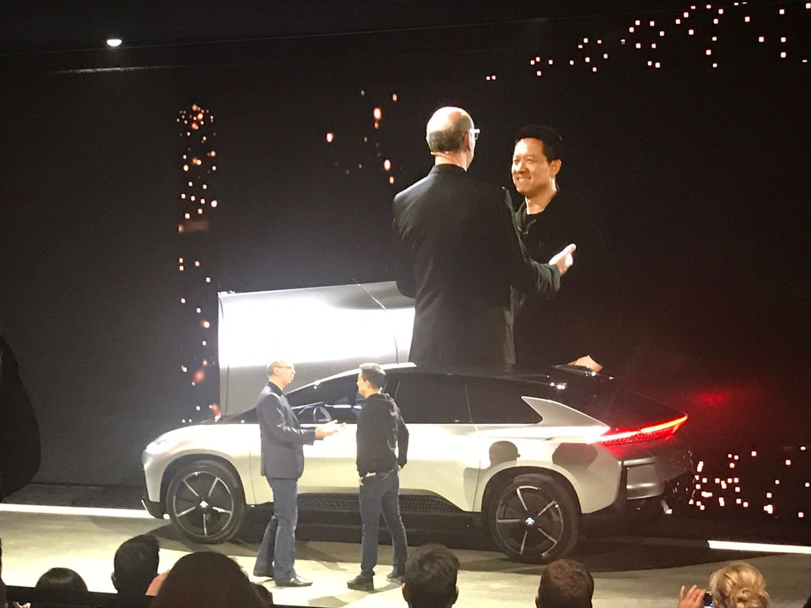 Nick Sampson, SVP of R&D & Engineering for Faraday Futures welcomes Jia Yuetieng, Chief Executive Officer of LeEco to the stage during their press conference at CES 2017.
